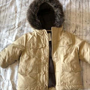 Tan down coat with fur lined hood